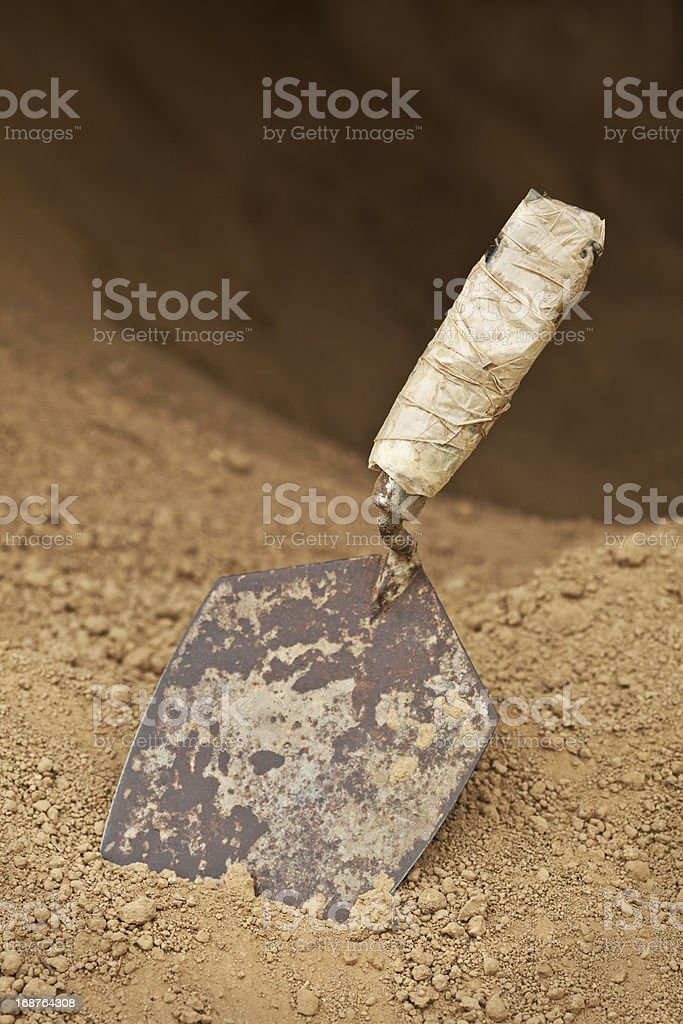 Old Trowel at Entrance to Small Dark Cave stock photo