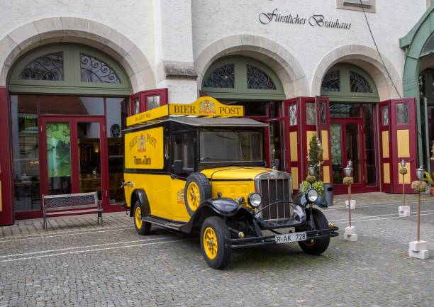 Old truck in the old town of Regensburg in Bavaria Germany stock photo