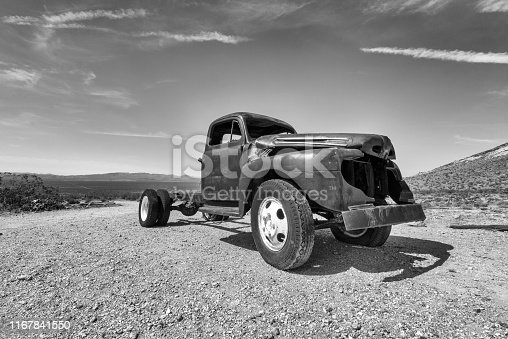 Abandoned and rusty truck in a ghost town in the desert of death Valley.
