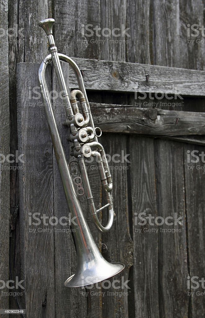 Old trumpet on the fence stock photo