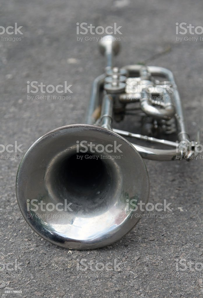 Old trumpet on the ground stock photo