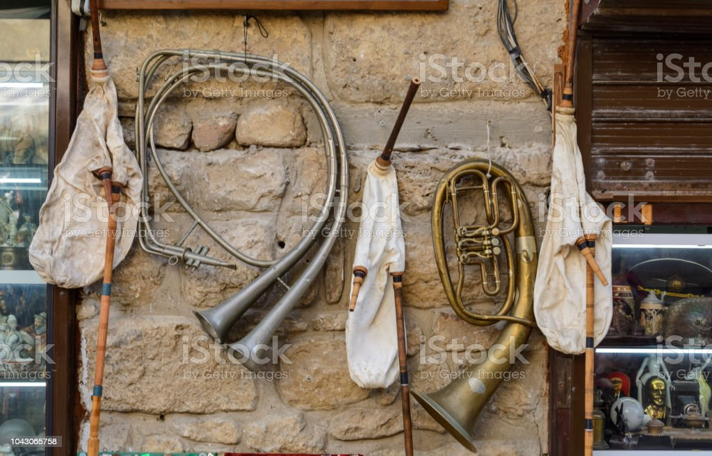 old Trumpets and bagpipes on a wall of a souvenir shop. stock photo