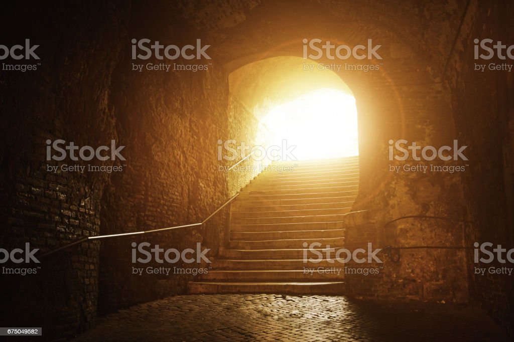 Old tunnel with stairs up to the light, Rome, Italy stock photo