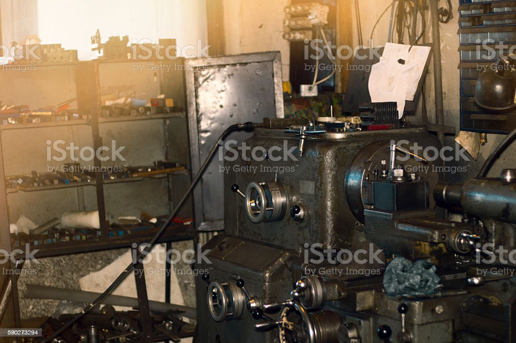 Old turning machine workshop. Turning lathe in the workshop.