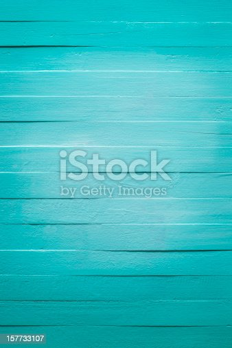 Old turquoise wooden panel background.