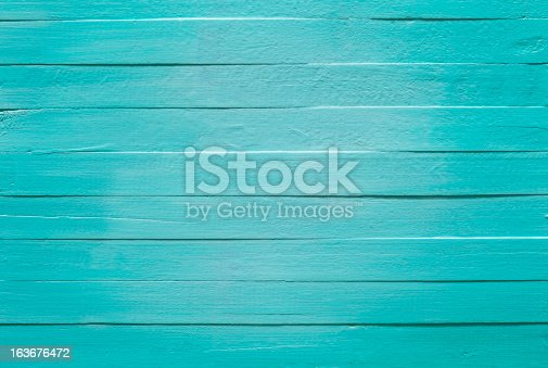 istock Old turquoise wooden panel background. 163676472