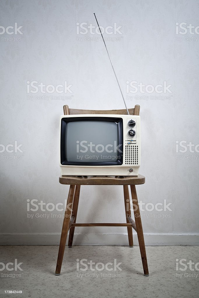 Old TV on a chair royalty-free stock photo