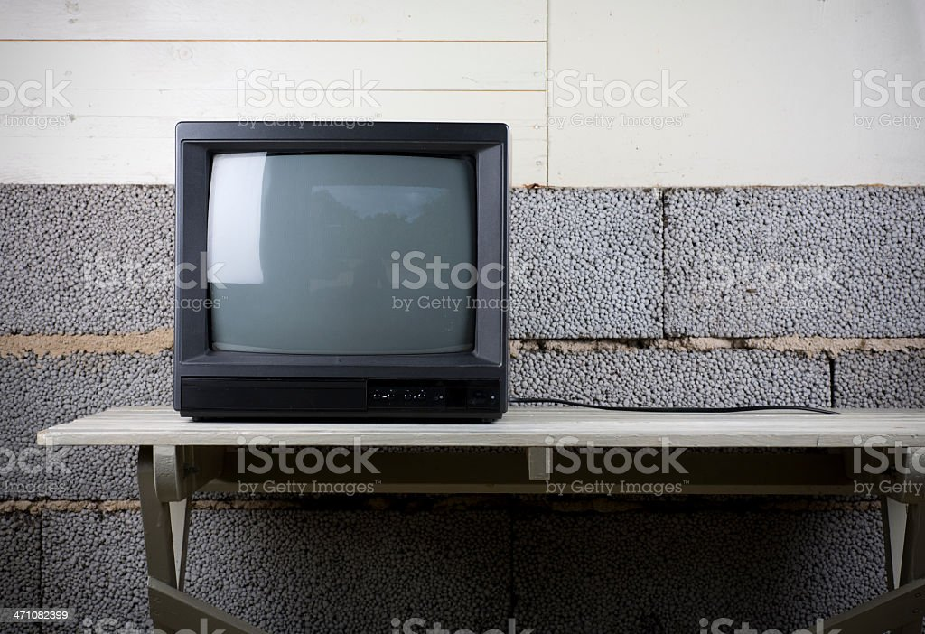 A retro style TV set. Some grunge style background.