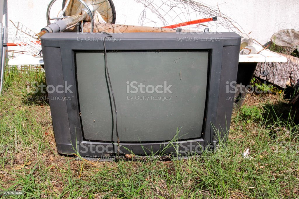Old TV set dumped and left in the garden along with other bulky...