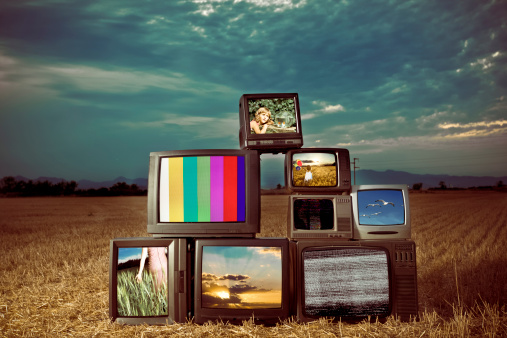 Old Televisions outdoors - All images from my portfolio - Added some grain.