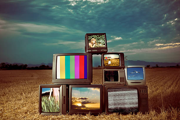 Old TV Show Old Televisions outdoors - All images from my portfolio - Added some grain. medium group of objects stock pictures, royalty-free photos & images