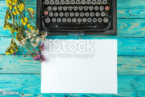 istock Old typewriter and a blank sheet of paper 502155018