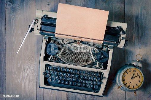 istock Old typewriter and alarm clock 803606318