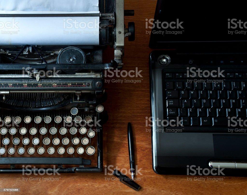 Old typewriter and laptop stock photo