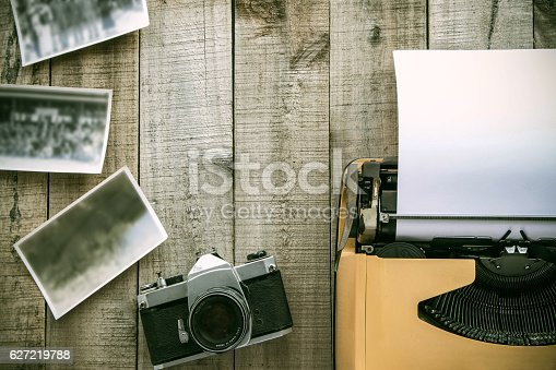 istock old typewriter and old camera on wooden floor vintage style 627219788