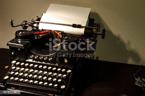 istock Old typewriter close-up. 1075223622