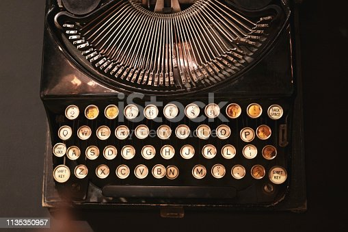 istock Old typewriter from above on black background 1135350957