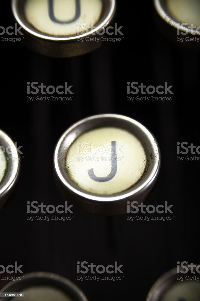 Old Typewriter - J Key stock photo