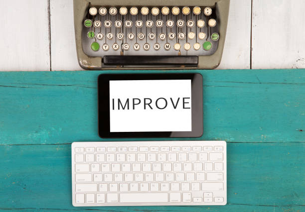 old typewriter keyboard and modern computer keyboard and tablet pc with word