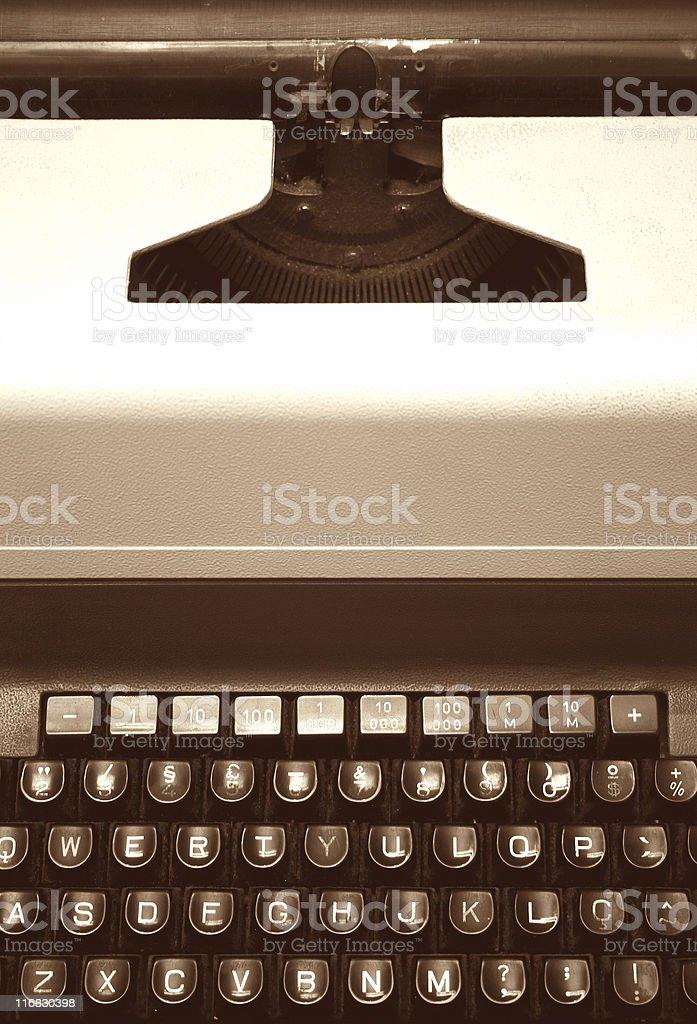 Old typewriter machine - in sepia tone royalty-free stock photo