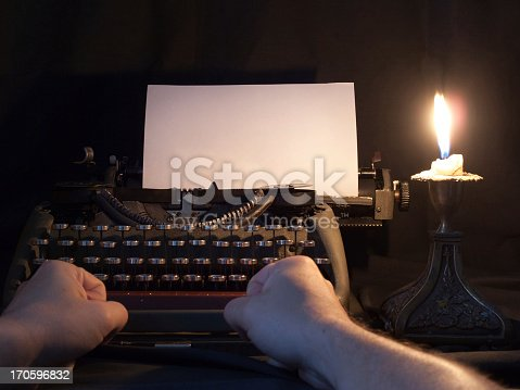 Old typewriter with candle