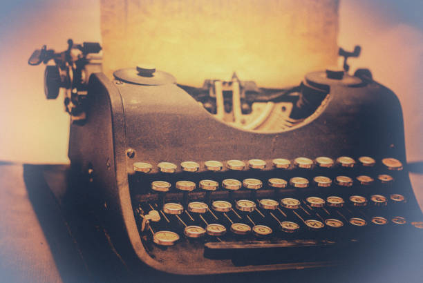 old typewriter toned with a retro vintage filter effect - sepia stock photos and pictures