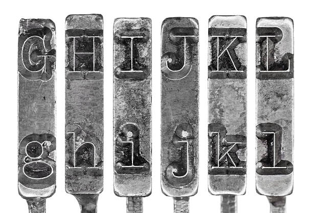Old Typewriter Typebar Letters G to L Isolated on White stock photo