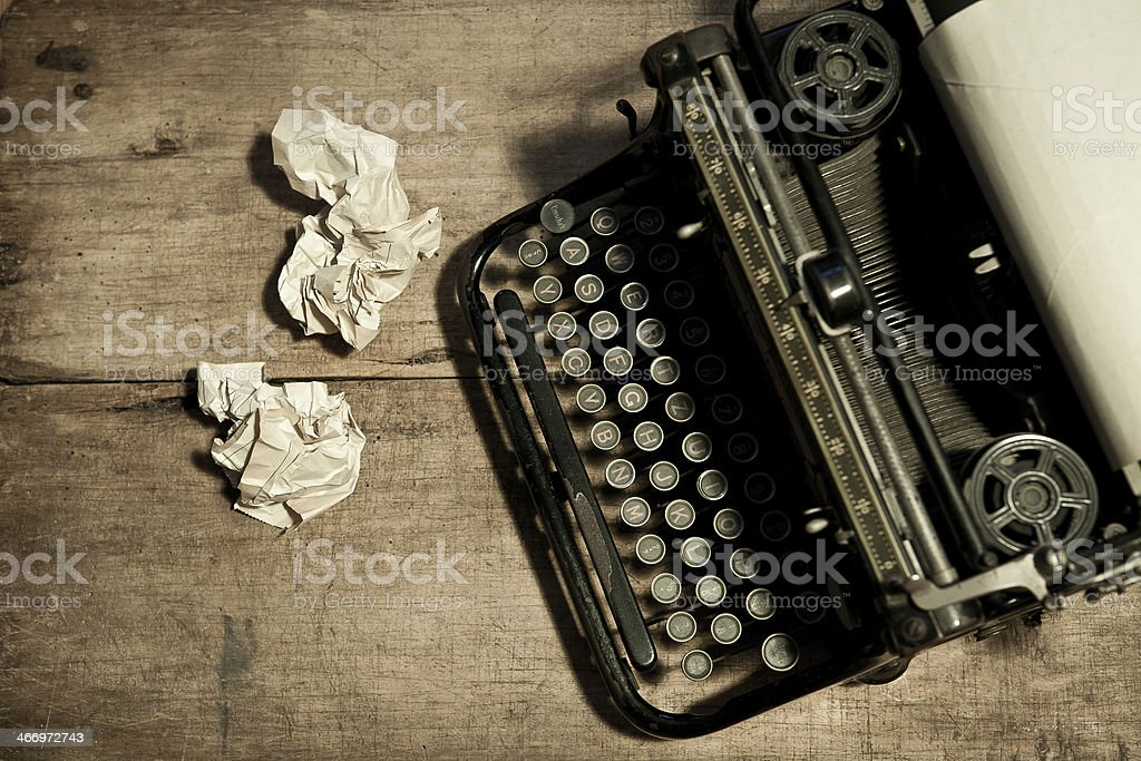 old typewriter with crumpled paper stock photo