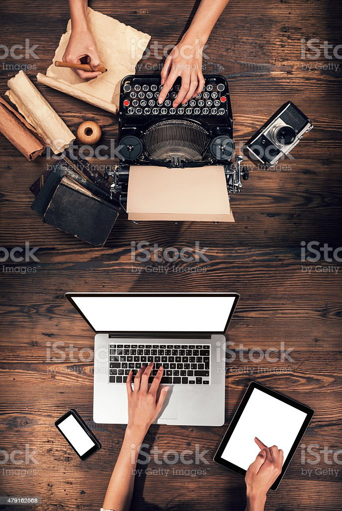 Old typewriter with laptop, concept of old and new stock photo