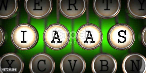 IAAS on Old Typewriter's Keys on Green Background.