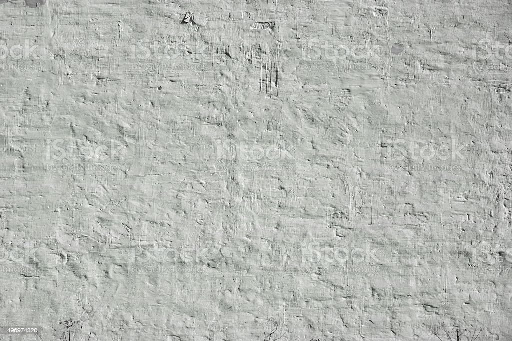 Old Uneven Brick Wall With White Painted Plaster Background stock photo