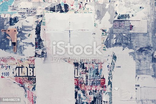 istock Old Urban Street Billboard With Torn Posters And Stickers 546466228