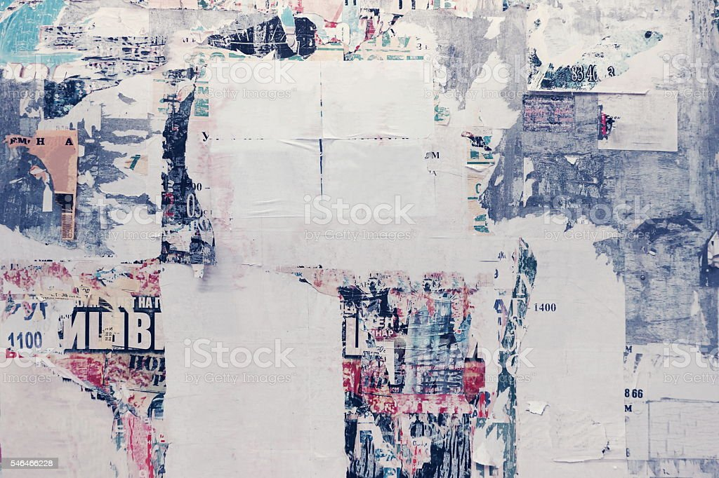 Old Urban Street Billboard With Torn Posters And Stickers stock photo