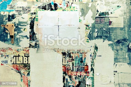 531421454 istock photo Old Urban Street Billboard With Torn Posters And Stickers 547210958