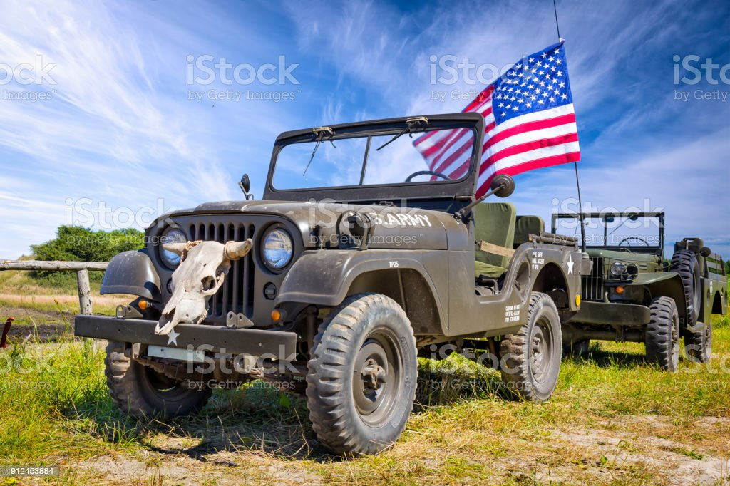 Old Us Army Jeep With Us Flag And Half Ton Truck Dodge Stock Photo