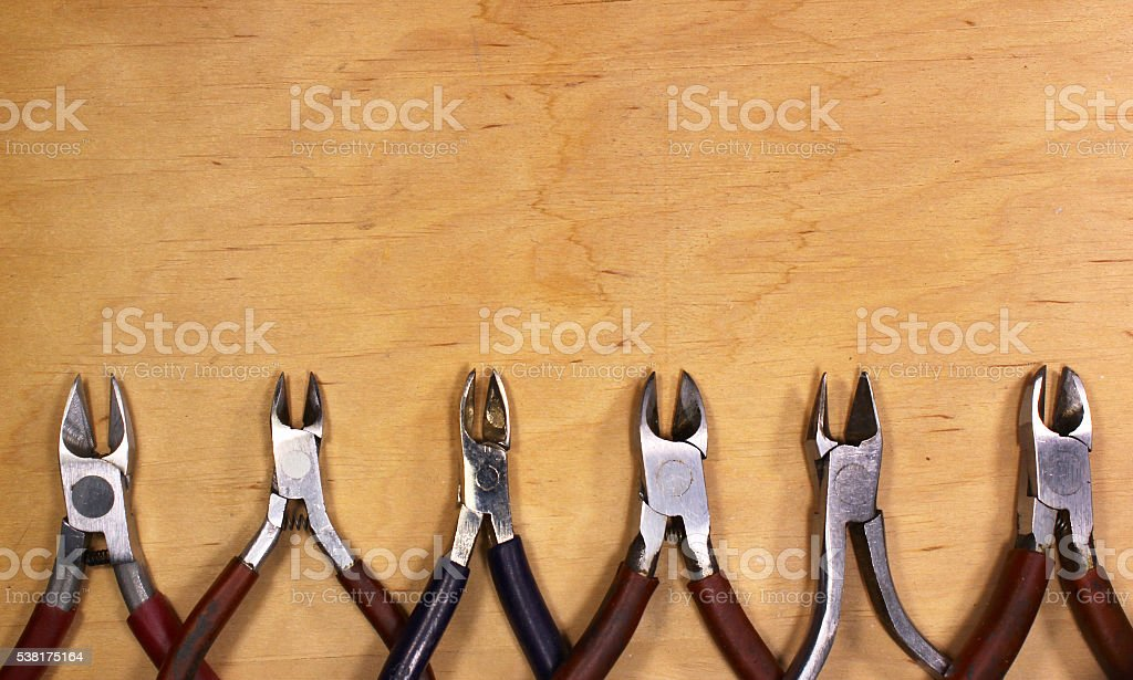 Old used and dirty metal pliers and cutters stock photo