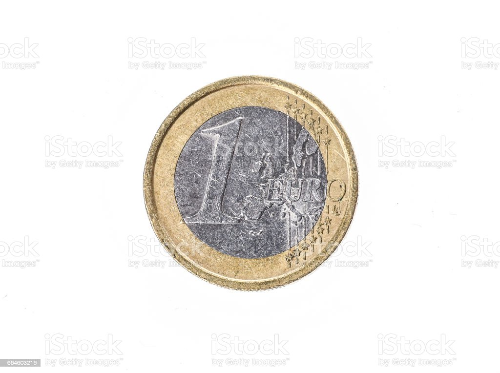 Old used and worn out 1 euro coin €. stock photo