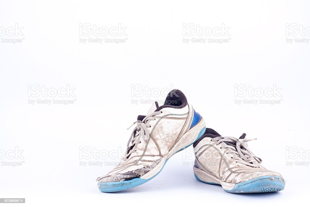 Old used  blue worn out futsal sports shoes stock photo