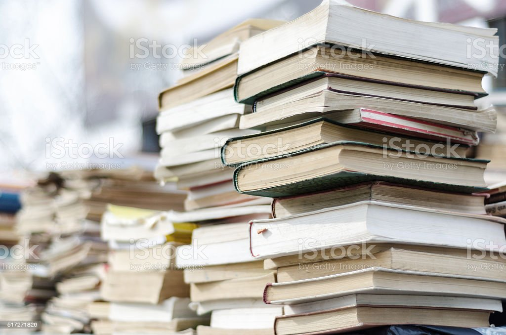 Old used books on a large mound stock photo