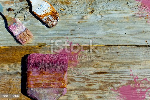 istock Old used brushes for paint on a wooden background. Repair, painting, renovation of interior. The place to advertise. 838116806