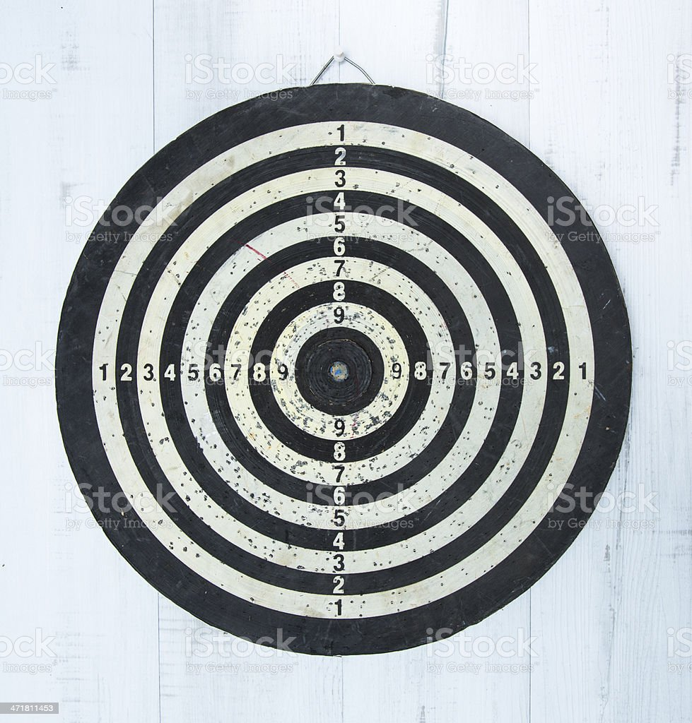 Old used bull\'s eye hanging on wall.