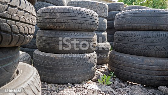 Old used car tires stacked in piles
