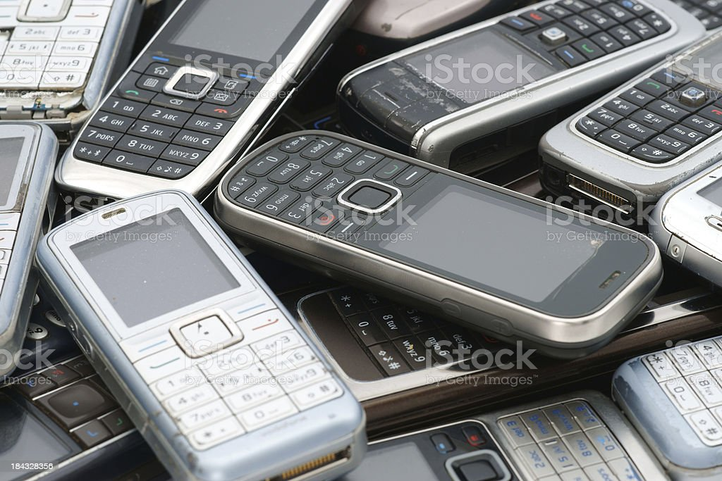 Old used cellphones pile as background royalty-free stock photo
