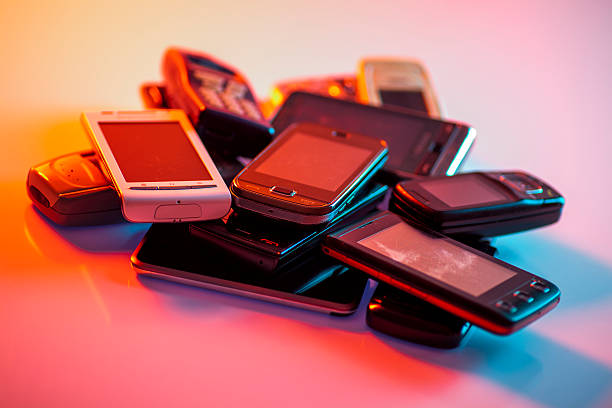 Old used cellphones pile stock photo
