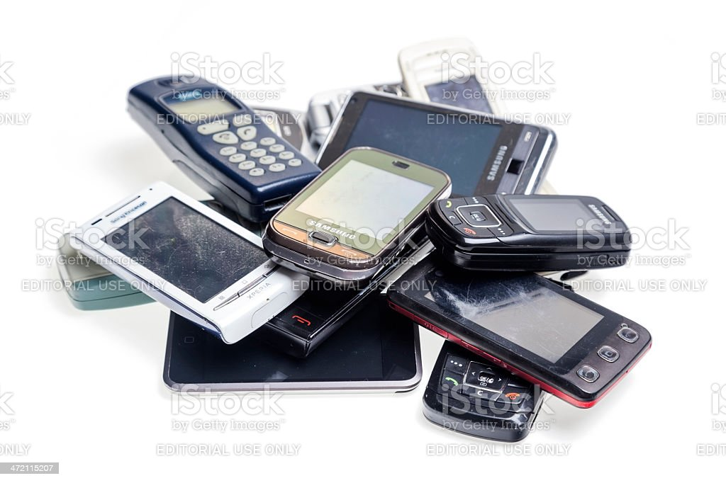Old used cellphones pile