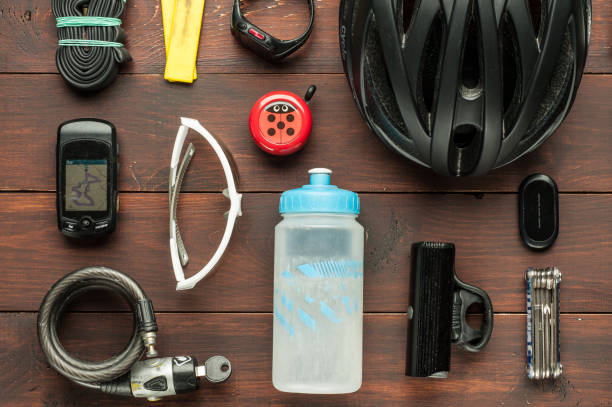 old used cycling accessories on wooden table stock photo