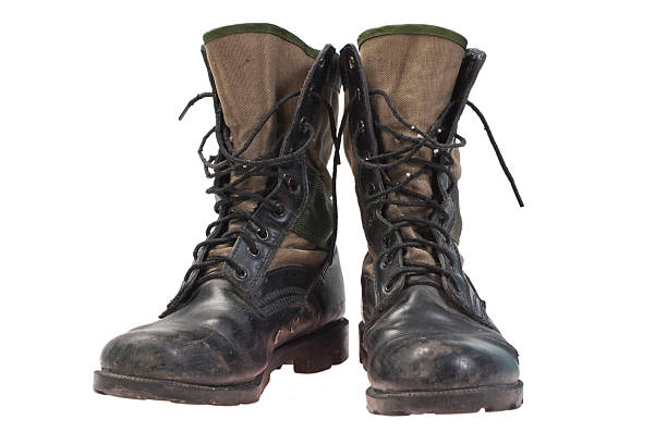 old used jungle boots isolated - postal worker stok fotoğraflar ve resimler