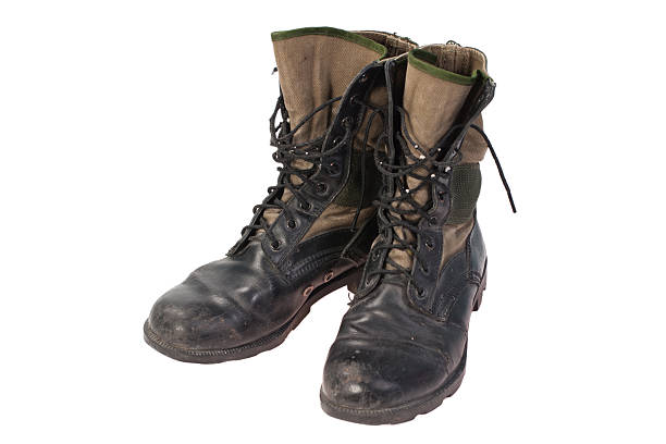 old used jungle boots vietnam war period isolated - postal worker stok fotoğraflar ve resimler