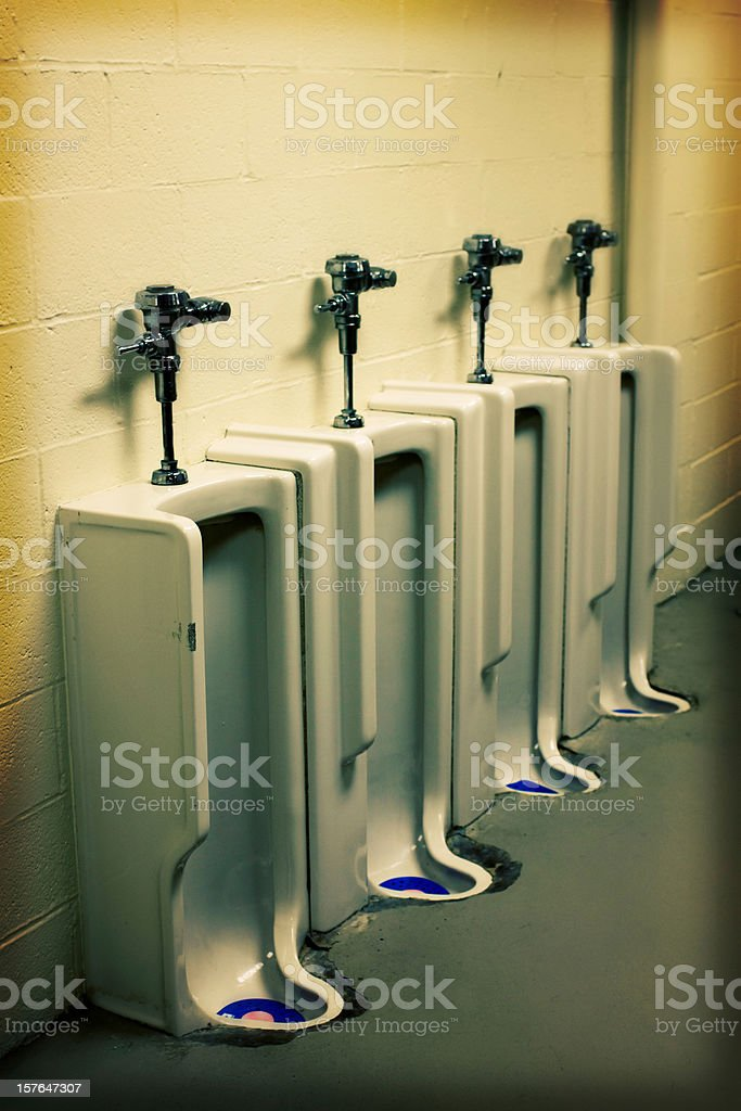 Old utilitarian urinal in bathroom - Effect stock photo