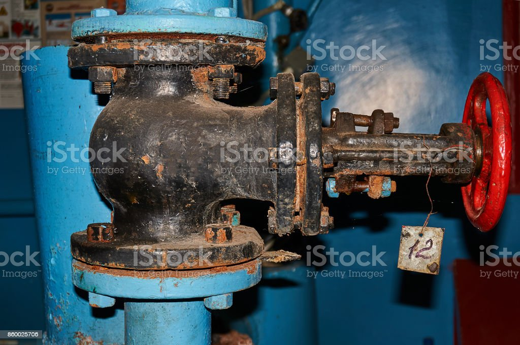 Old valve on the water pipeline close-up stock photo
